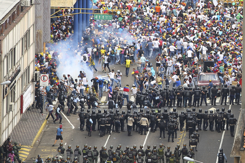 National police forces use tear gas to disperse students and protesters on the streets of San Cristobal. Source: iStock / camacho9999