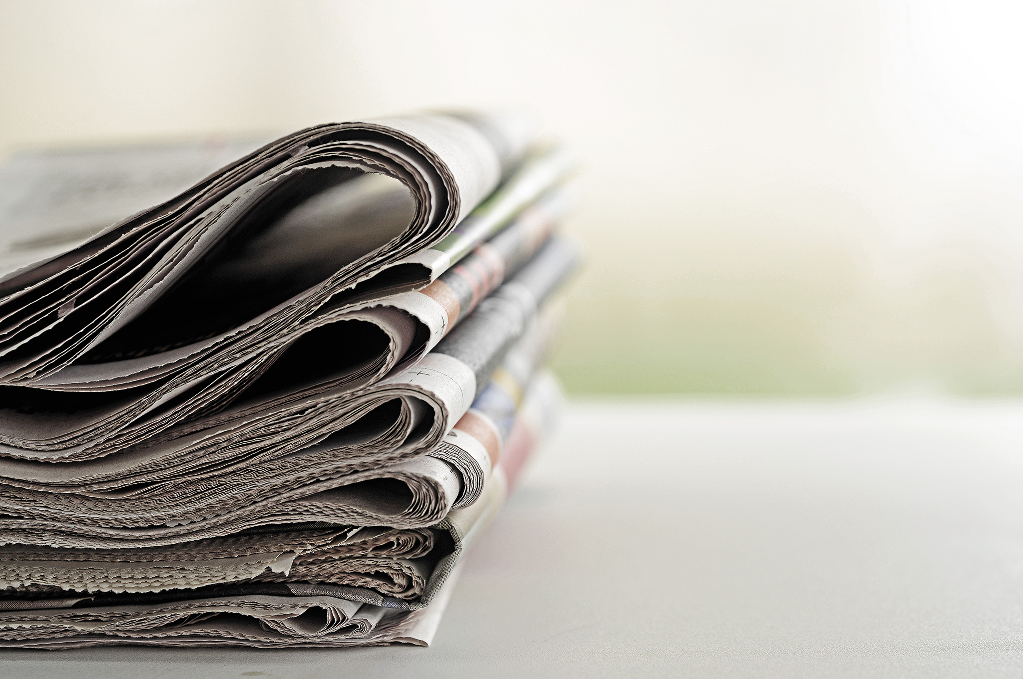 stack-of-newspapers