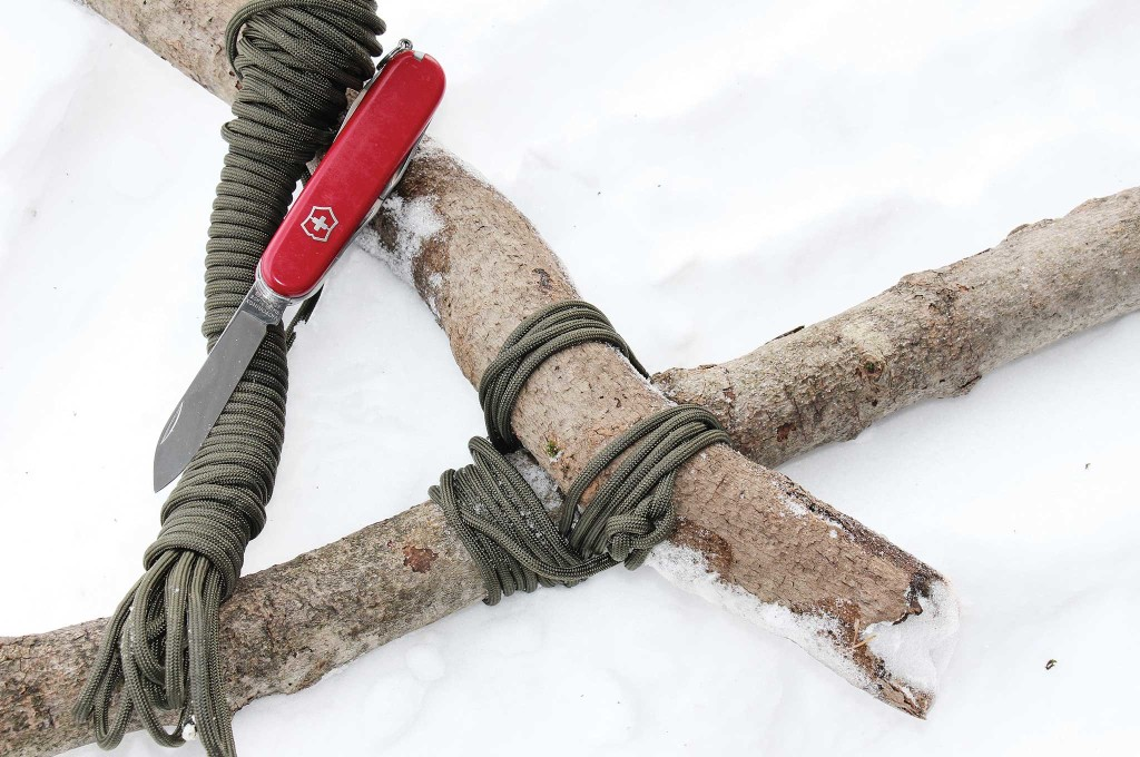 Paracord works fine for lashing wood, and the Swiss Army knife cuts the 'cord to just the right lengths.