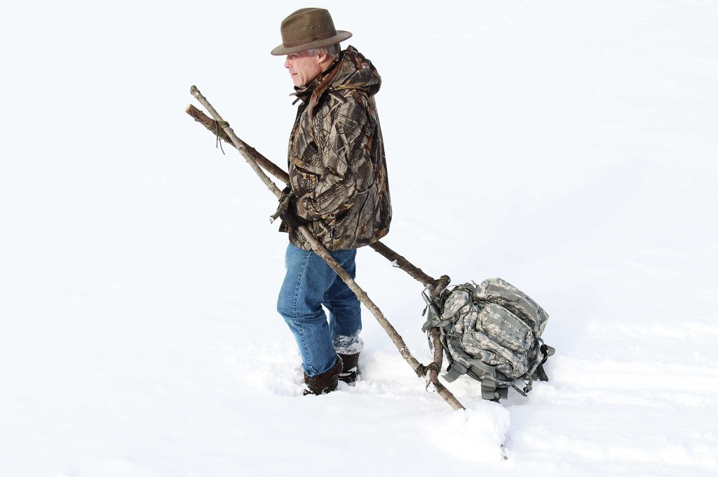The author tests his finished travois with a pack attached to simulate the load. A travois can be a lifesaver when used to transport an injured companion.