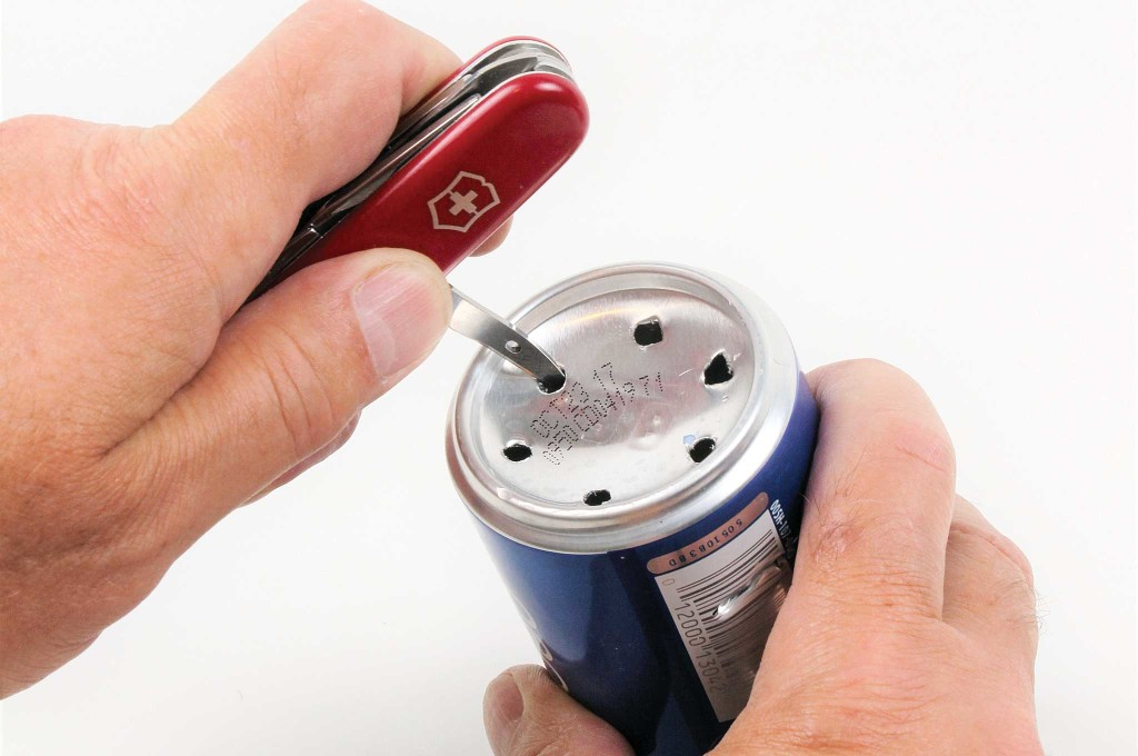-5-surprising-uses-for-the-swiss-army-knife-soda-can-stove-001