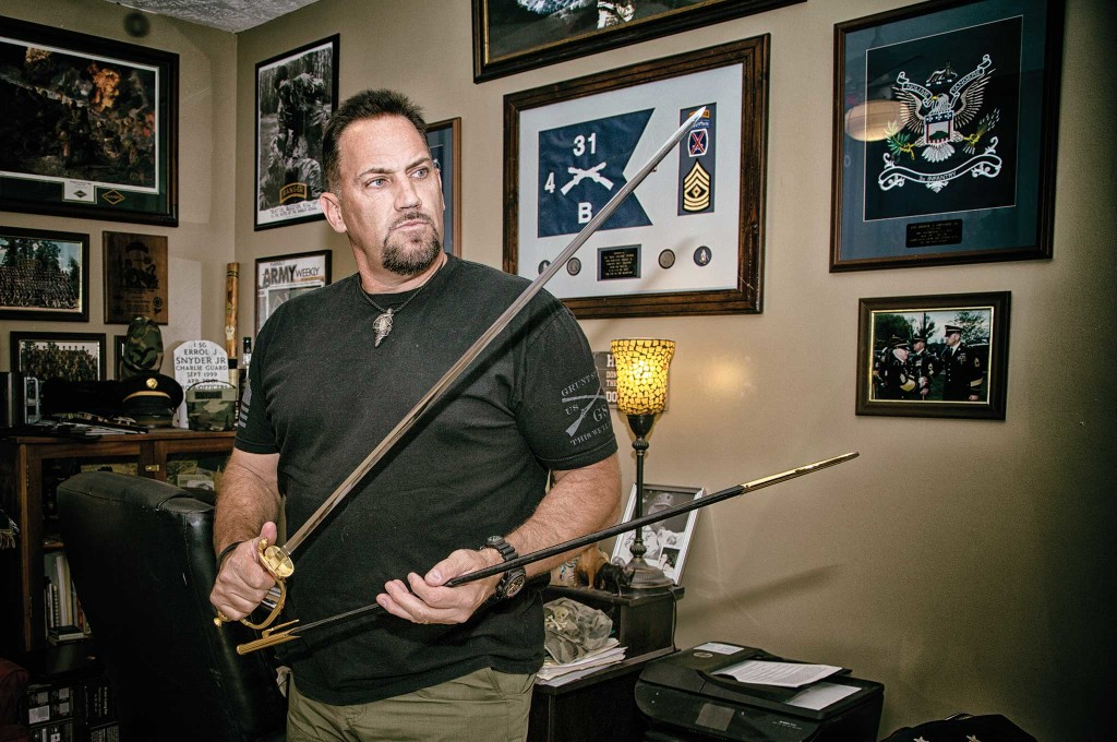 Snyder with a ceremonial sword from his time as the First Sergeant of the 3rd US Infantry Regiment, Charlie Guard, from 1999-2001.