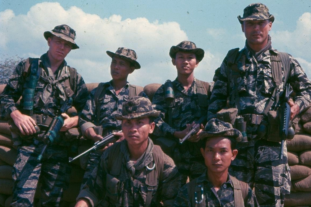 Members of the 5th Special Forces Group and Vietnam Special Forces (VNSF) soldiers wearing boonie hats. Photo: S. L. A. Marshall Photograph Collection